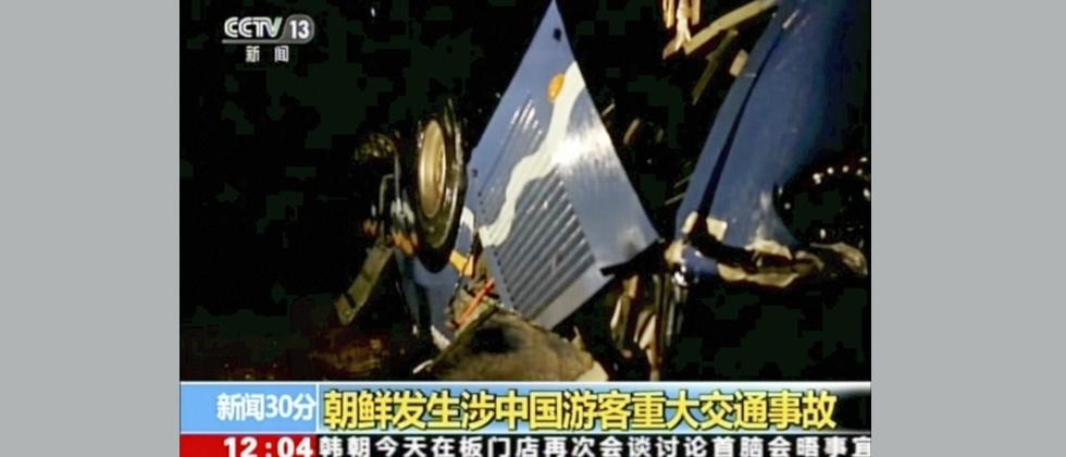 In this Sunday, April 22, 2018, image taken from video footage by China's CCTV via AP Video, a bus which carries Chinese and North Koreans is seen overturn after an accident in North Hwanghae province, south of Pyongyang, North Korea. A traffic accident i