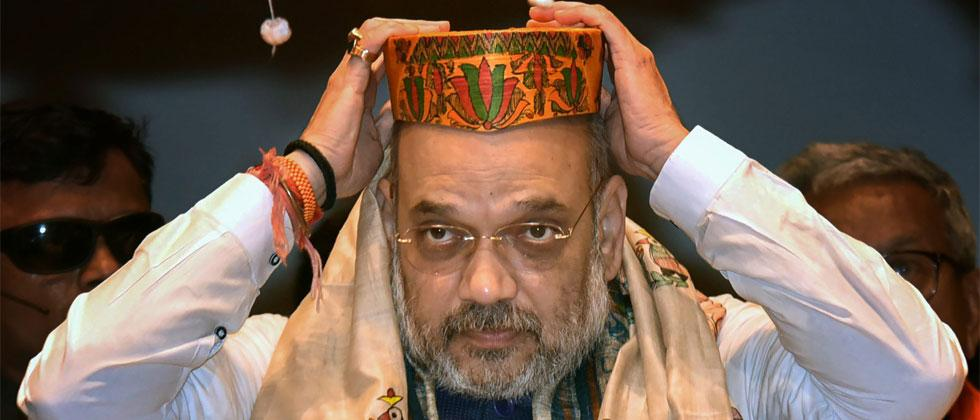 BJP President Amit Shah wears 'Mithala Pag' during a meeting with office-bearers of 'Shakti Kendra', in Patna on Thursday, July 12, 2018. PTI Photo