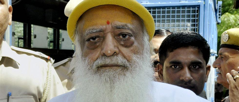 File photo of Asaram Bapu being produced in Jodhpur court in connection with the sexual harassment case. PTI Photo