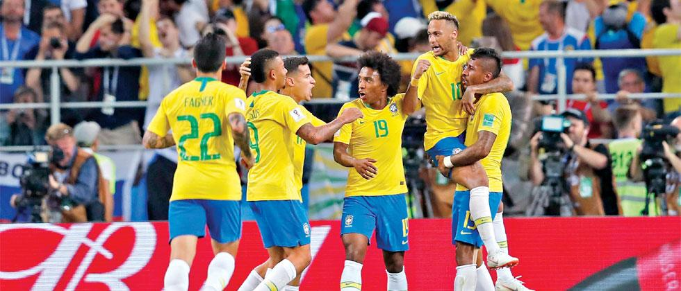 Brazil players celebrate scoring a goal during the group E match against Serbia at the 2018 soccer World Cup in the Spartak Stadium in Moscow on Wednesday