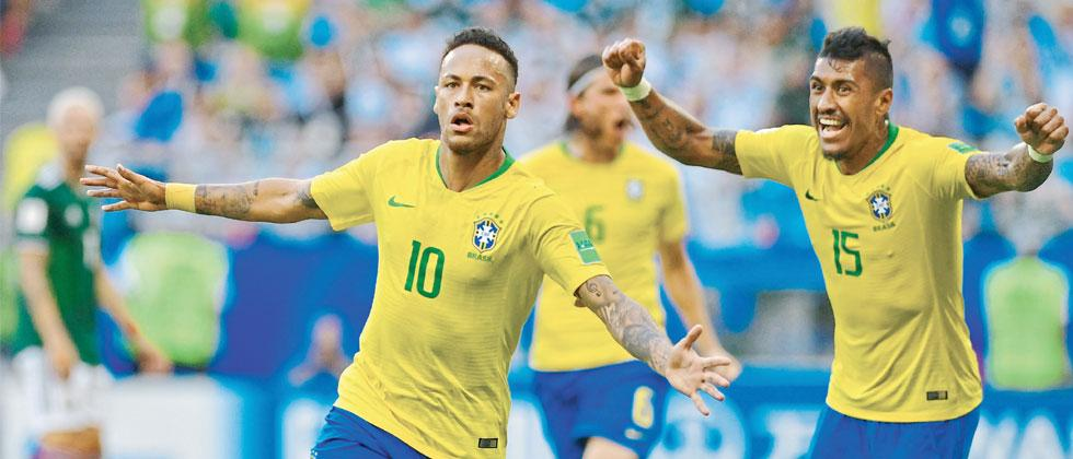 Brazil's Neymar (L) celebrates scoring the opening goal against Mexico during the round of 16 match at the Samara Arena in Samara on Monday