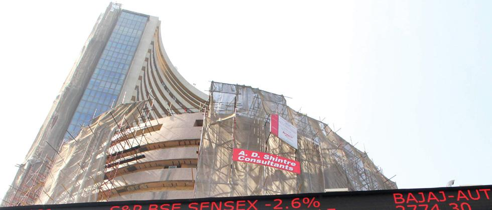 Sensex, Nifty touch record high