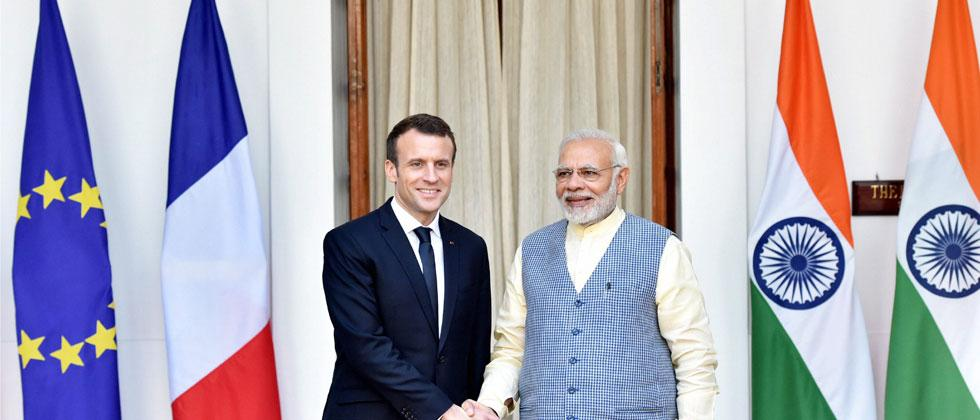 Prime Minister Narendra Modi shakes hands with French President Emmanuel Macron before their meeting at Hyderabad House in New Delhi on Saturday. Photo/Vijay Verma/PTI