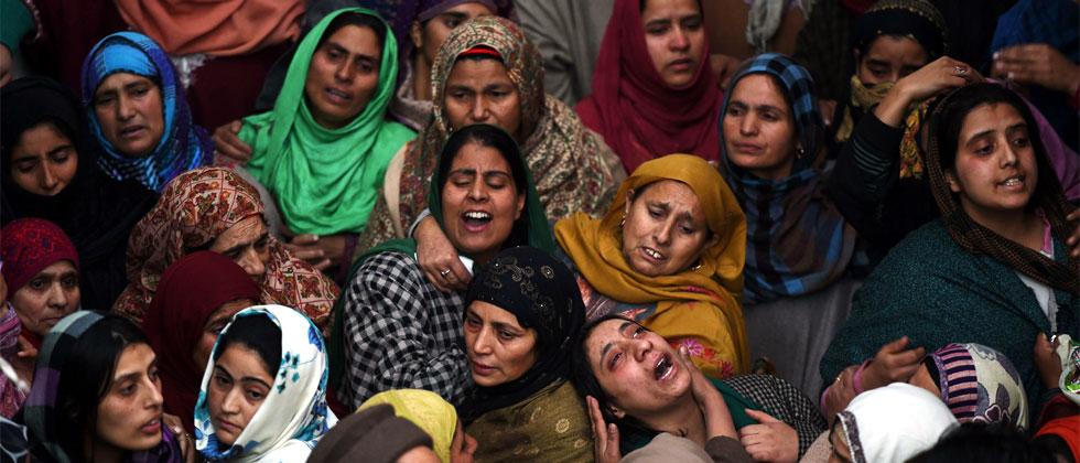 Kashmiri relatives and friends of slain Indian paramilitary soldier Sharief-Ud-Din-Ganaie mourn during his funeral at Nagam Chadoora vilage of central Budgam district