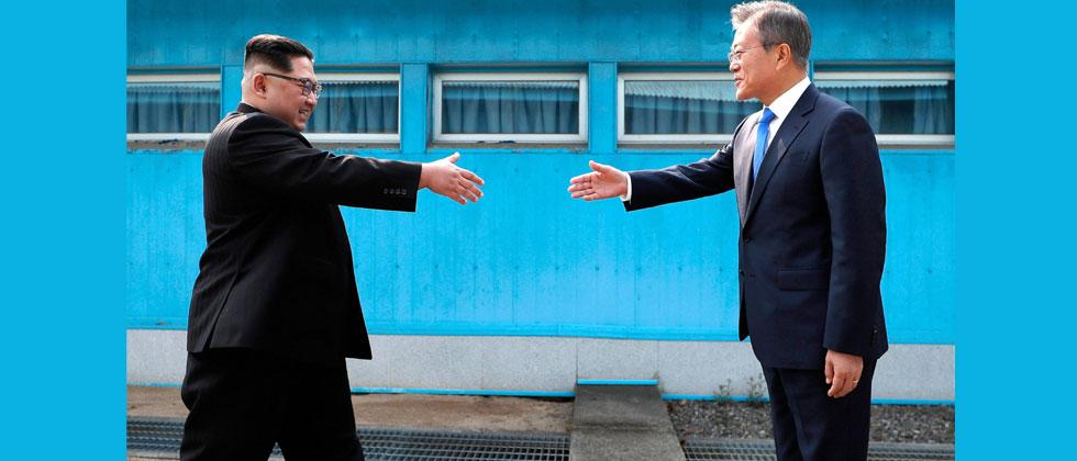 North Korean leader Kim Jong Un, left, prepares to shake hands with South Korean President Moon Jae-in over the military demarcation line at the border village of Panmunjom in Demilitarized Zone Friday, April 27, 2018. AP/PTI