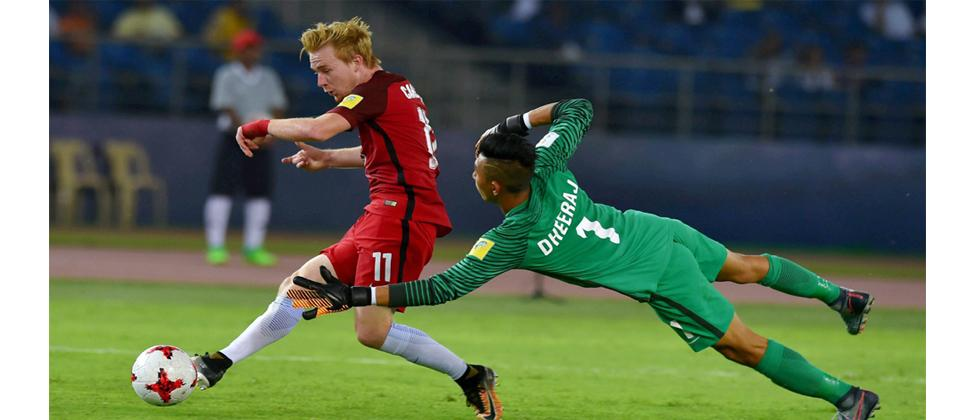 Indian goalkeeper Dheeraj fails to save as USA's Carleton scores the 3rd goal against India during their U-17 FIFA World cup match against USA in New Delhi on Friday. PTI Photo