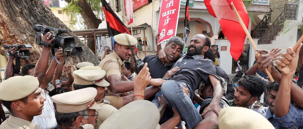 Police personnel try to detain members of Thanthai Periyar Dravida Kalagham protesting against the judgement of Supreme court on the Cauvery river issue, in Coimbatore on Friday. PTI Photo