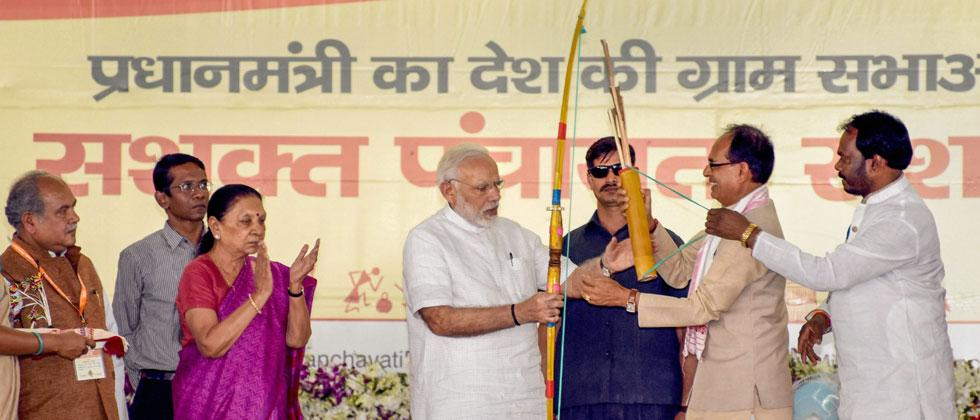 PM Narendra Modi being presented a memento by MP Chief Minister Shivraj Singh Chouhan on the occasion of the National Panchayati Raj Day 2018, at Mandla in Madhya Pradesh on Tuesday. PTI Photo