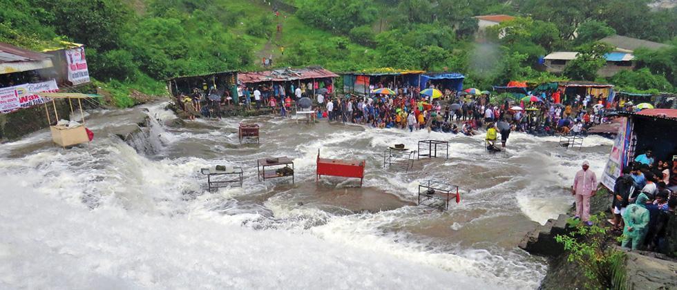 Tourists at Bhushi Dam in Lonavla.