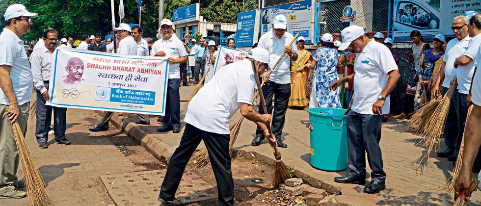 BoM conducts cleanliness drive outside office bldg