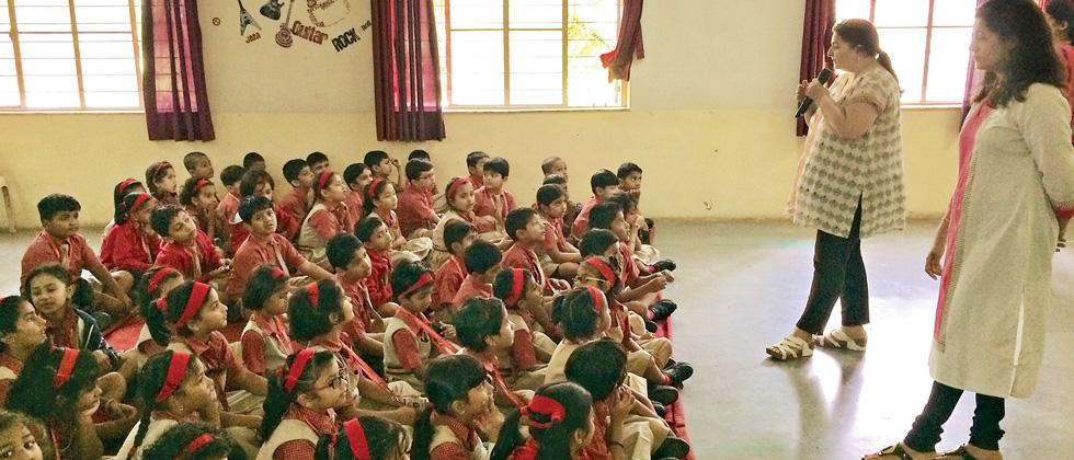 Manisha Desai and Radhika Pandhare interact with the students of CM International School during a session.