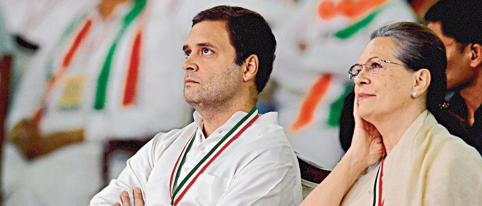Congress Chairperson Sonia Gandhi (R) and President Rahul Gandhi look on during the 84th Plenary Session of Indian National Congress at the Indira Gandhi Stadium in New Delhi