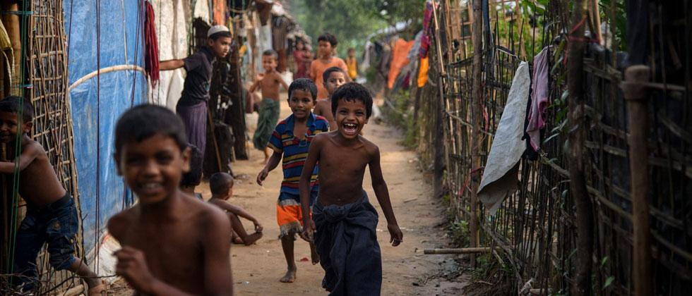 Rohingya refugee children run through the Kutupalong refugee camp near Cox's Bazar on August 10, 2018. Ed Jones/AFP