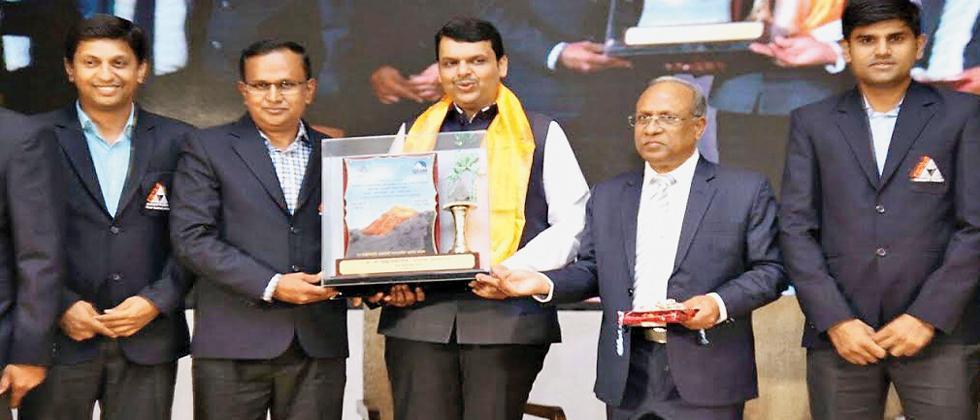 Members of Giripremi group being felicitated by CM Devendra Fadnavis in Mumbai.