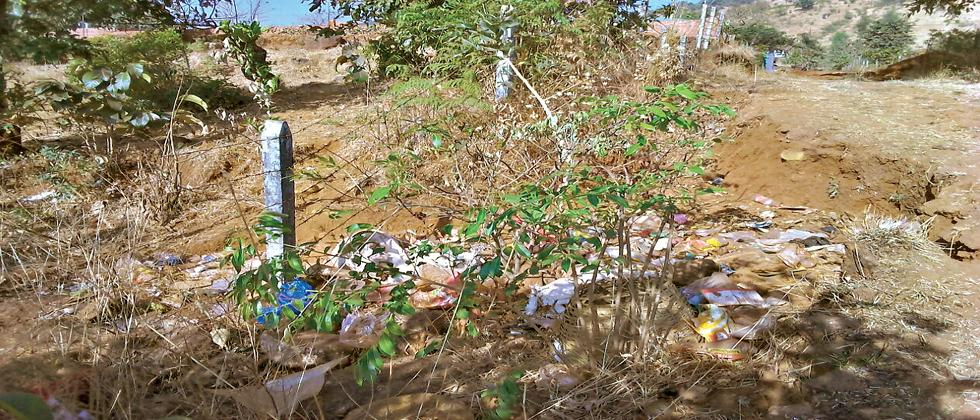 Plastic and alcohol bottles are being dumped near Humbarali village, which is  located in the buffer zone of Sahyadri Tiger Reserve.