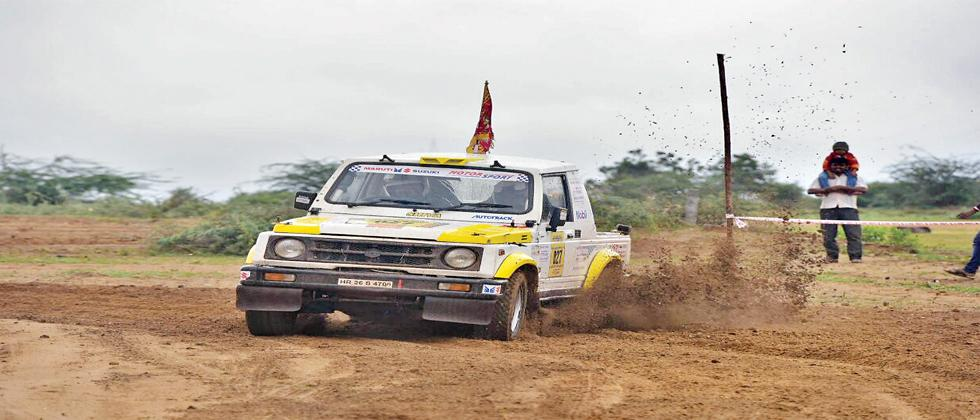 Spectators view the action unfold in front of them as Shivakumar Reddy in his Maruti Gypsy gets past during the Maruti Suzuki Dakshin Dare Cross-country rally on Tuesday.