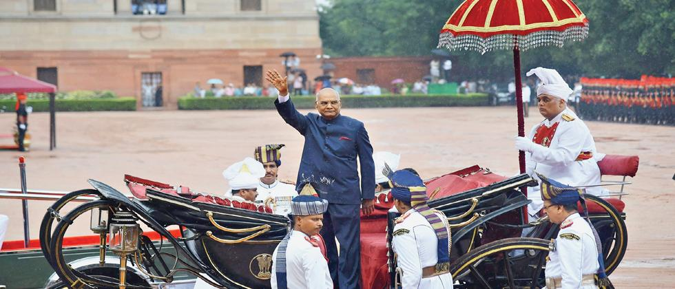 Newly sworn-in President Ram Nath Kovind waves as he leaves in a regal buggy after inspecting a guard of honour in the forecourt of the Rashtrapati Bhavan in New Delhi.