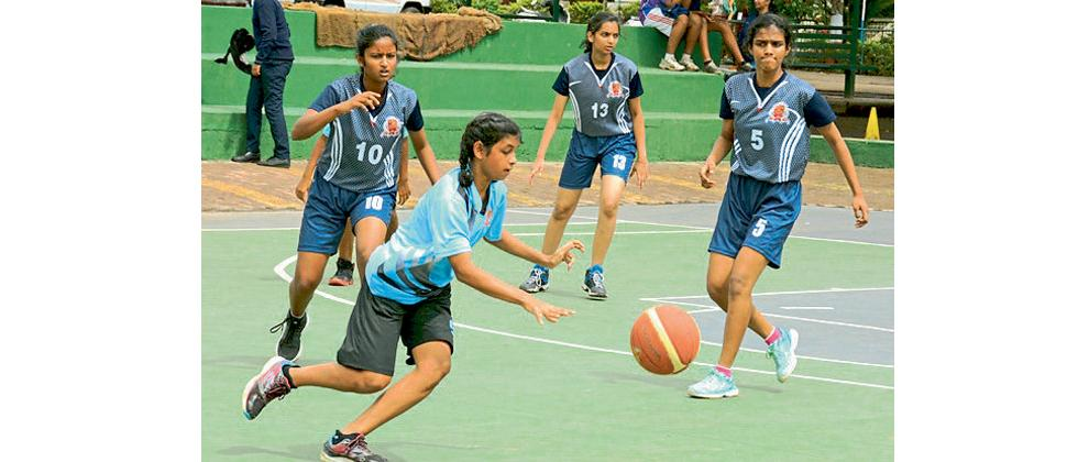 A player from Bishop's School, Undri (light blue) controls the ball during their match against Bishop's School Kalyaninagar at the Barnes School & Junior College, Devlali.