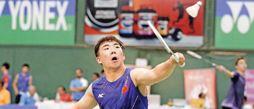 Guo Xinwa of China in action against Kim Moon Jun of Korea on Friday.