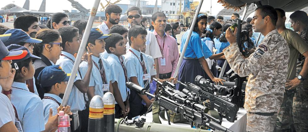 School students being briefed about advanced weapons during a static display at 85th anniversary celebrations of IAF at air force station in Lohegaon on Sunday.