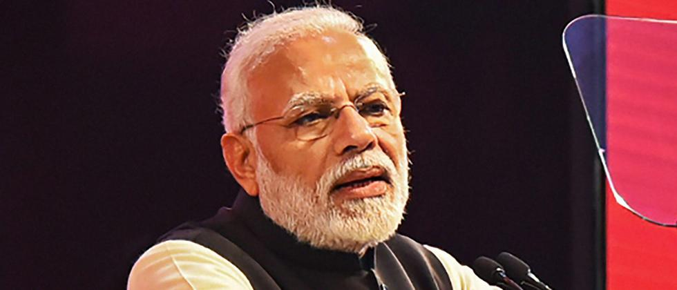 PM targets Cong at NRI meet, says BJP govt stopped loot