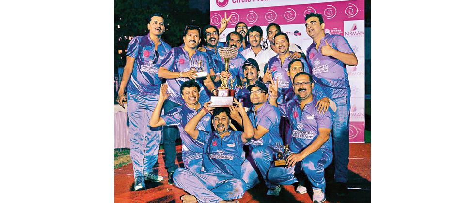 Maharashtra Papers XI team members poses with the trophy after registering 16-runs victory over Nirman Developers XI at Kataria High School ground, Mukundnagar.