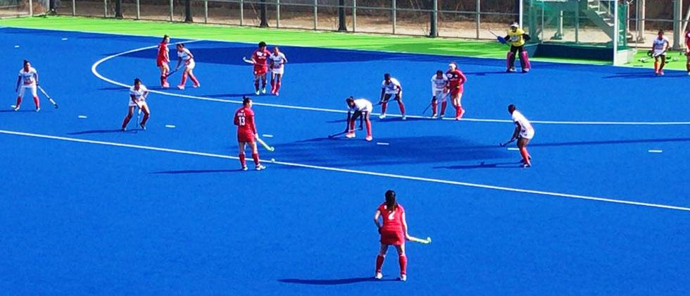 South Korea players prepare to take a free hit against India in their second match