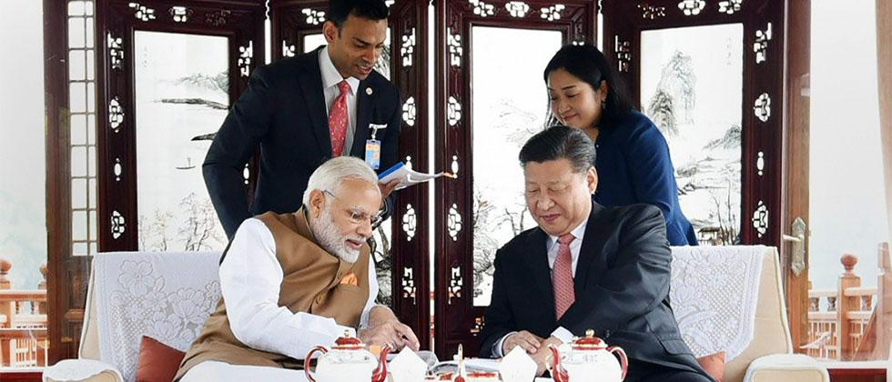 Prime Minister Narendra Modi with Chinese President Xi Jinping inside a house boat, in Wuhans East Lake, China on Saturday. PTI Photo/PIB