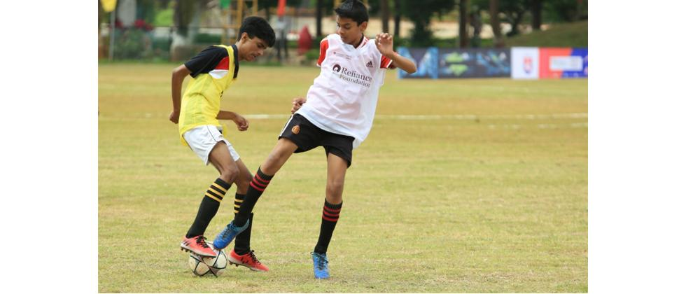 Global Indian International School (yellow) edged past SNBP School in a thrilling RFYS junior boys match at B.K. Birla Centre of Education, Pune
