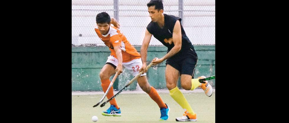 A match in progress at the Major Dhyan Chand Poligras hockey stadium, Pimpri on Wednesday