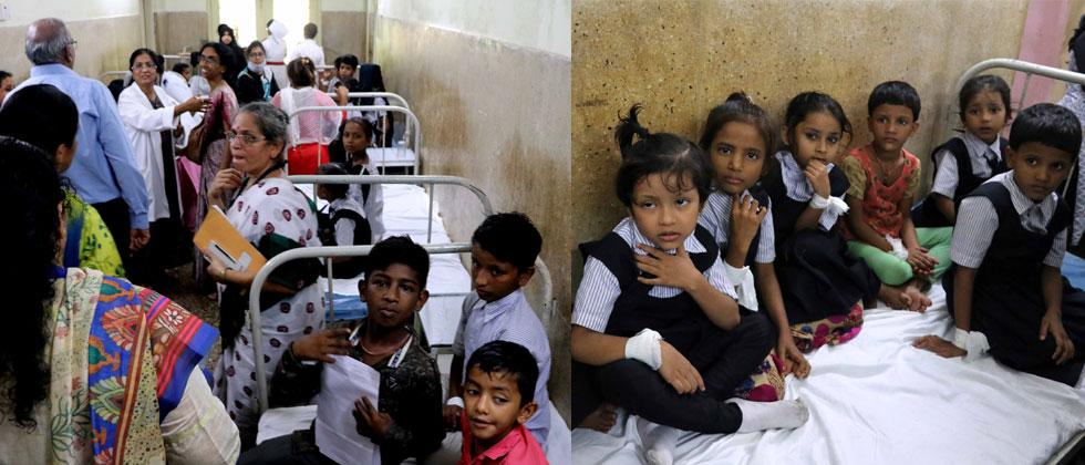 Children being admitted to Rajawadi Hospital in Ghatkopar after the death of a girl student with suspected medicine poisioning. Prashant Sawant/Sakal Times