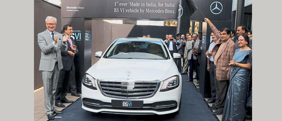 (L) Roland Folger, MD & CEO, Mercedes-Benz India, (2nd R) Nitin Gadkari, Union Road Minister and Rashmi Urdhwareshe, Director, ARAI during the unveiling of the first 'BS VI' compliant, Made in India vehicles in Mumbai.