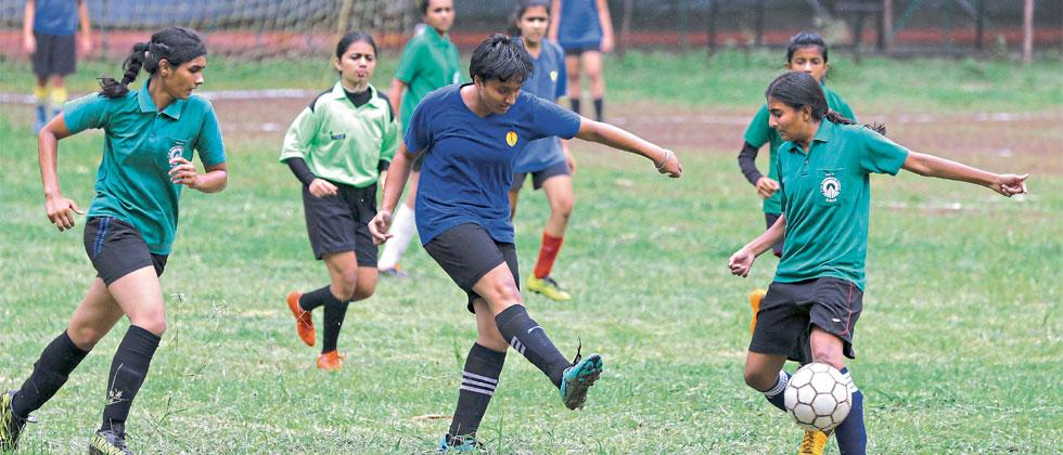 Players of City International School, Kothrud (in blue) in action against The Orchid School, Baner on Wednesday. Parag Jadhav/Sakal Times