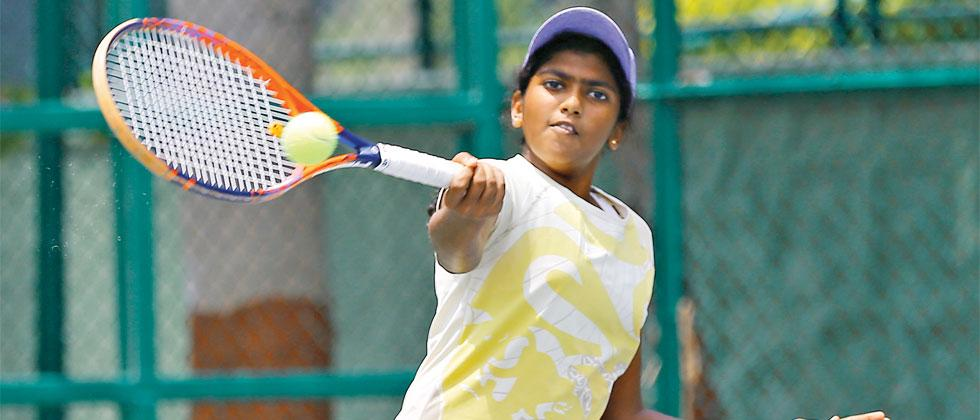 Abinava Sweeton of Canada in action against Shubhangee Laxmi Shah during the Asian Under-14 Tennis Tournament at Balewadi Sports Complex on Tuesday. Vaibhav Thombare/Sakal Times