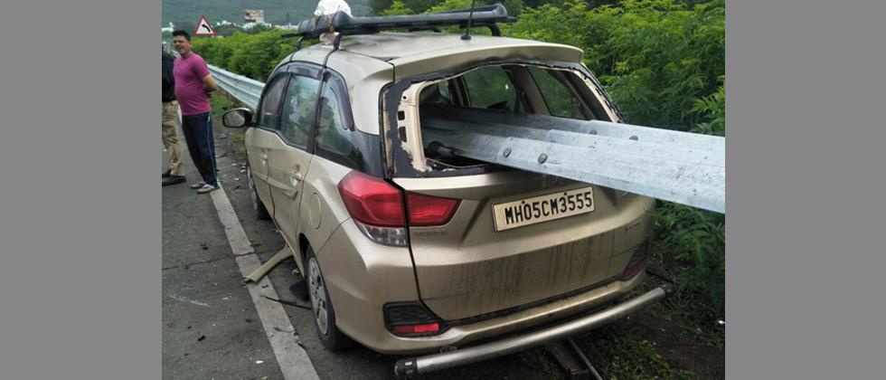 The car which rammed into the guardrail safety barrier on the Mumbai-Pune Expressway near Somatane on Tuesday morning