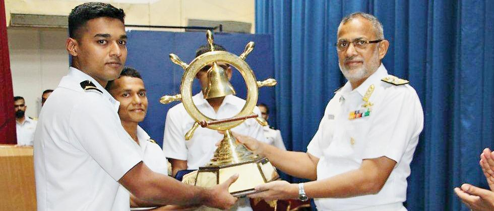SLt Aravind Pankaj receiving the Late Lt Ali Ghose Trophy for Positive Living from Vice Admiral KO Thakare, Project Director Ship Building Centre, Visakhapatnam.