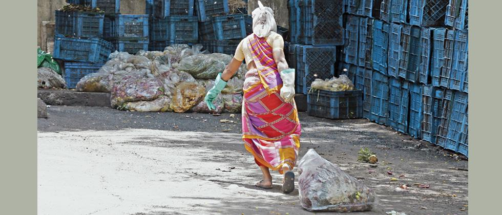 Even though plastic bags are not allowed for any purpose, a conservancy staffer was seen using a plastic bag to carry garbage inside the garbage yard at Aundh.