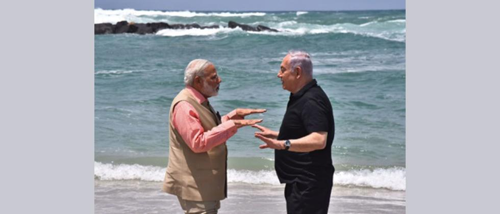 Indian Prime Minister Narendra Modi and Isreali Prime Minister Benjamin Netanyahu gesture as they talk on Olga Beach in Hadera.