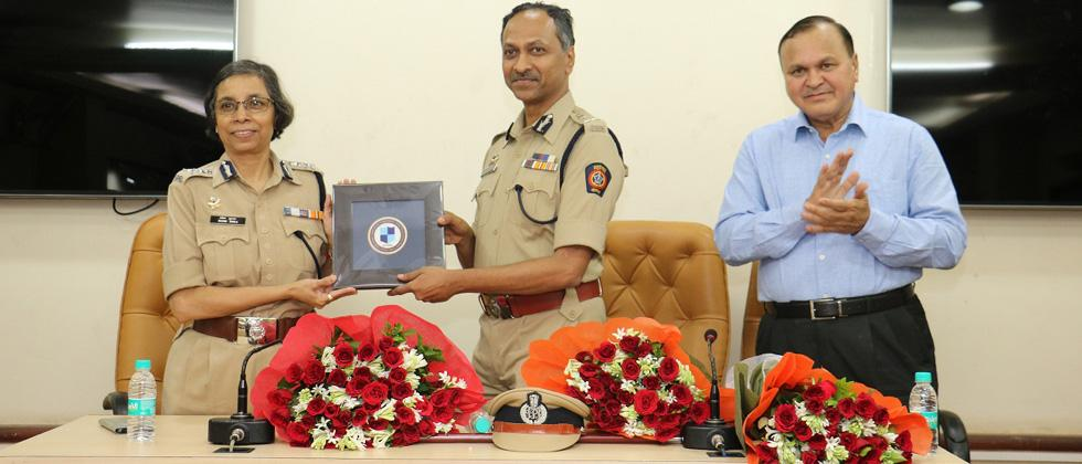 Outgoing Commissioner of Pune Police Rashmi Shukla(left) handing over the charge to new Pune police commissioner K Venkatesham(center). Outgoing Joint commissioner of Pune police Ravindra Kadam is also seen.