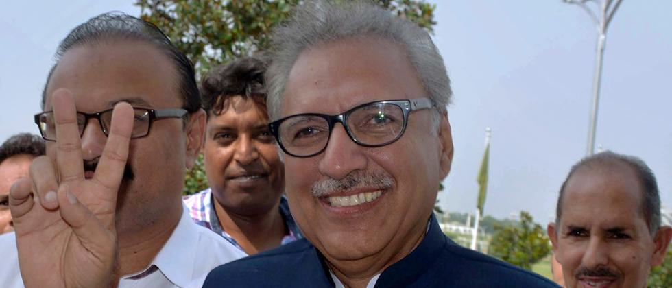 Arif Alvi, presidential candidate from the ruling PTI party, makes a victory sign upon arrival at parliament in Islamabad, Pakistan on Tuesday. Polling started at Pak's parliament and 4 provincial legislatures to indirectly elect their new President.