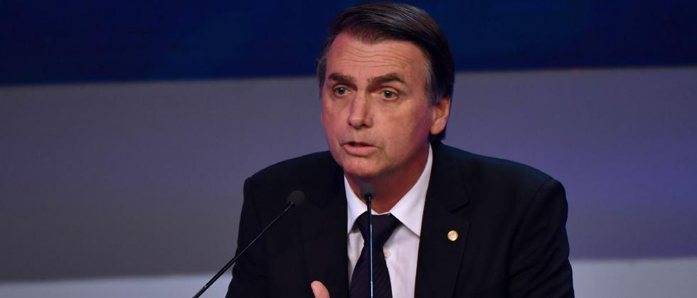 In this file photo taken on August 9, 2018 Brazilian presidential candidate Jair Bolsonaro (PSL), speaks during the first presidential debate ahead of the October 7 general election, at Bandeirantes television network in Sao Paulo, Brazil.