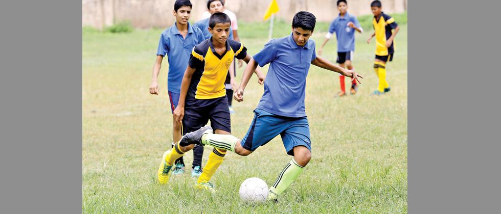 A player from City International School, Kothrud, vies for the ball during their match against Nagarvala Boarding School at PDFA Ground in Dobarwadi on Saturday.