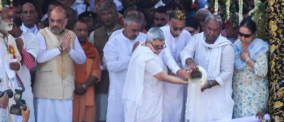 Former Prime Minister Atal Bihari Vajpayee's daughter Namita Kaul Bhattacharya and son-in-law Ranjan Bhattacharya immerse his ashes in the Ganga at Har ki Pauri, in Haridwar on Sunday. Also seen are BJP President Amit Shah and UP CM Yogi Adityanath.
