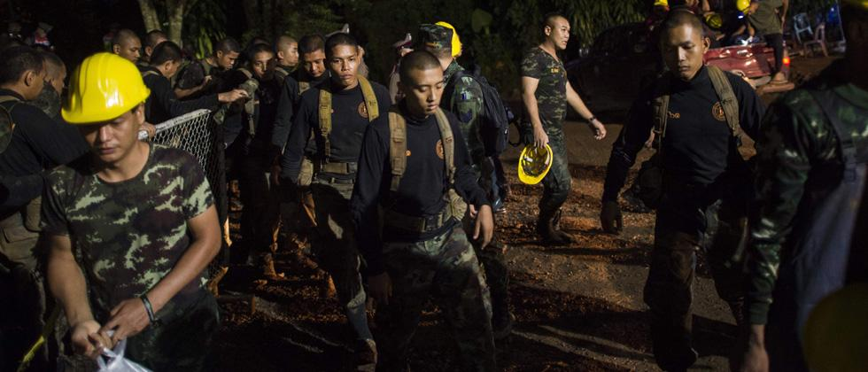 Thai soldiers are seen at the Tham Luang cave area as operations continue for the 12 boys and their coach trapped at the cave in Khun Nam Nang Non Forest Park in the Mae Sai district of Chiang Rai province on Friday.