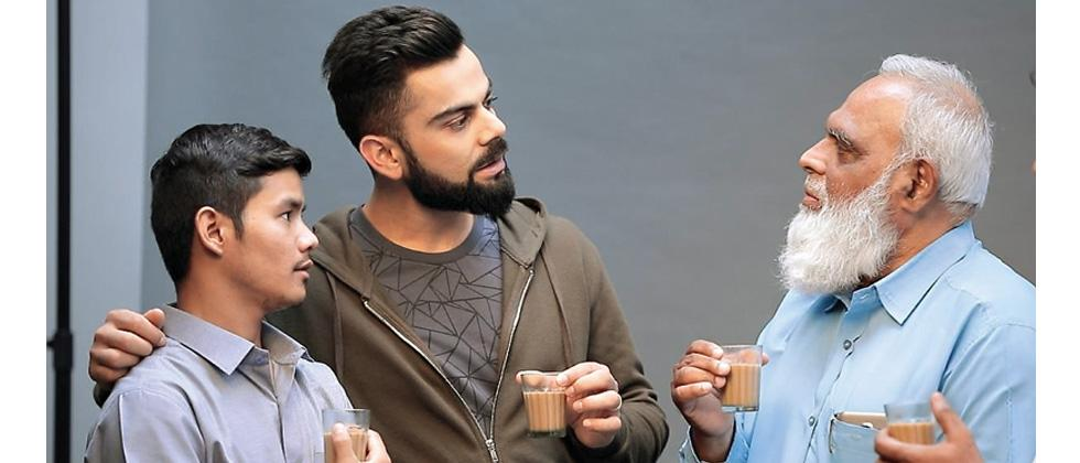 Virat Kohli enjoys a cup of tea with Uber drivers.