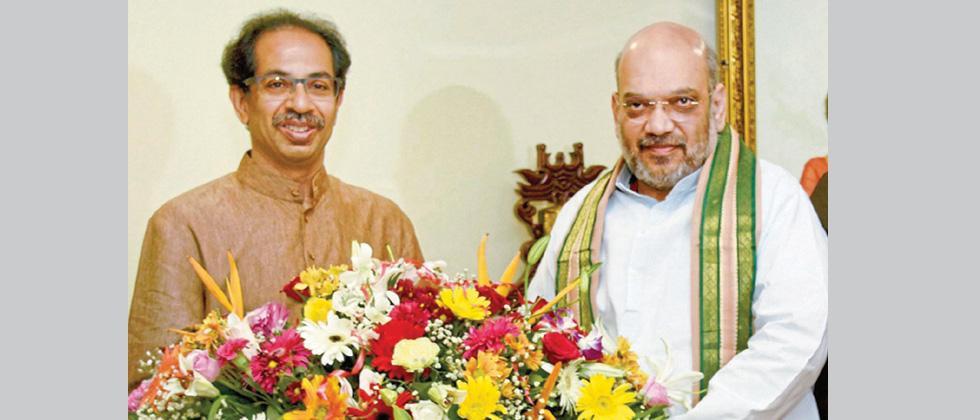 A file photo of Shiv Sena Chief Uddhav Thackeray (L) and Amit Shah at 'Matoshri' in Mumbai.