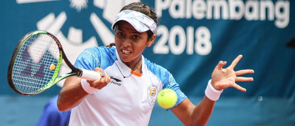 mixed day: Ankita Raina hits a return against China's Zhang Shuai in their women's singles tennis semi-final match at the 2018 Asian Games in Palembang on Thursday.