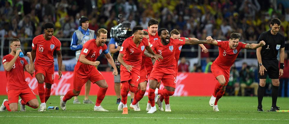 England's players celebrate winning the penalty shootout at the end of the Russia 2018 World Cup round of 16 football match between Colombia and England at the Spartak Stadium in Moscow on July 3, 2018. Yuri Cortez/AFP