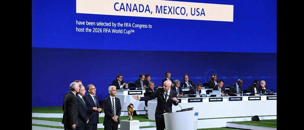 FIFA president Gianni Infantino (R) addresses the United 2026 bid (Canada-Mexico-US) officials Carlos Cordeiro, Decio de Maria Serrano, Steve Reed following the announcement of the 2026 World Cup host. Kirill Kudryavtsev/AFP