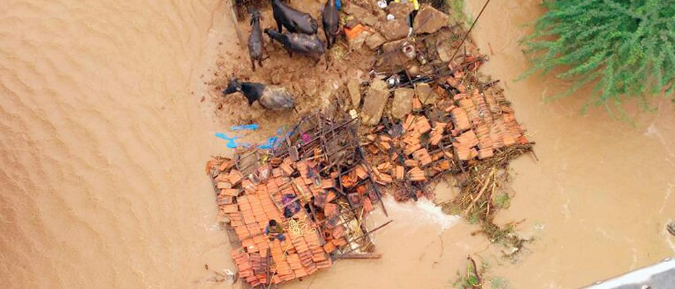 An IAF helicopter airlifting flood-hit people at a flood-affected village in Banskantha district in Gujarat, on Tuesday.
